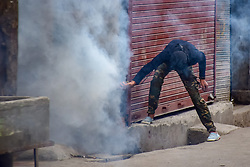 June 15, 2018 - Srinagar, Jammu & Kashmir, India - Kashmiri protesters clashes with Indian security forces during a protest in Srinagar, Indian Kashmir on Friday . Government forces used tear gas and pellets on Kashmiris protestors who gathered after last Friday afternoon prayers , the Protestors were protesting against Indian rule in the disputed region. (Credit Image: © Abbas Idrees/SOPA Images via ZUMA Wire)