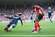 Sunderland forward Jeremain Lens (17)  sells Middlesbrough defender Antonio Barragan (17)  a dummy  during the Premier League match between Sunderland and Middlesbrough at the Stadium Of Light, Sunderland, England on 21 August 2016. Photo by Simon Davies.