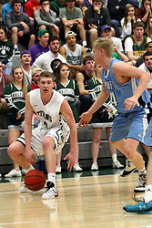 20 February 2016:  Andy Stempel(4) works the corner against Tucker Harlan during an NCAA men's division 3 CCIW basketball game between the Elmhurst Bluejays and the Illinois Wesleyan Titans in Shirk Center, Bloomington IL
