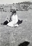 young couple posing in open field countryside 1950s