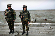 """Armenian Conscript Soldiers  on guard duty at the trenches on the front line with Azerbaijan, by the city of Agdam...Twelve years after a cease-fire agreement ended the 1988-1994 war, soldiers with the Nagorno-Karabakh army guard their positions, where occasional sniper shootings and firefights continue to erupt....Agdam is a ghost town which once had 160,000 residents and an airport. Under Armenian control since July 1993, most of the refugees from Agdam now live in camps and makeshift cities in Azerbaijan. Because of the level of destruction the city ruins are commonly known as the """"Hiroshima of Karabakh.""""Officially  cease-fire line is called ?Nagorno Karabakh Line of Contact ?.."""