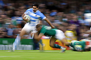 a pan blur image as Jeronimo De La Fuente of Argentina runs down the wing.  Rugby World Cup 2015 quarter-final match, Ireland v Argentina at the Millennium Stadium in Cardiff, South Wales  on Sunday 18th October 2015.<br /> pic by  Andrew Orchard, Andrew Orchard sports photography.