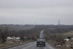 Driving through an abandoned roadside checkpoint between Lugansk and Debaltsevo.