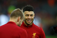 Alex Oxlade-Chamberlain of Liverpool has a laugh during the warm up. Premier League match, Liverpool v Leicester City at the Anfield stadium in Liverpool, Merseyside on Saturday 30th December 2017.<br /> pic by Chris Stading, Andrew Orchard sports photography.