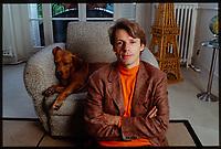 French actor Lambert Wilson at home with his dog in his Paris home. 25th September 1996.<br /> L'acteur et comédien français Lambert Wilson photographié chez lui à Paris avec son chien. 25 septembre 1996.