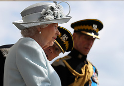 Queen Elizabeth II , Colonel-in-Chief Royal Scots Dragoon Guards (Carabiniers and Greys) with Colonel of the Regiment Brigadier H D Allfrey as she presents a new standard to the regiment at Leuchars Station in Fife.