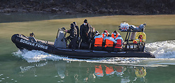DATE CORRECTION © Licensed to London News Pictures. 13/04/2021. Dover, UK. Migrants are helped ashore by Border Force officials at Dover Harbour in Kent after crossing the English Channel. Home Secretary Priti Patel has pledged an overhaul of asylum seeker rules, with refugees having their claim assessed based on how they arrive in the UK. Photo credit: Stuart Brock/LNP