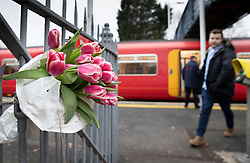 © Licensed to London News Pictures. 05/01/2019. Horsley, UK. A floral tribute has been placed on a gate at Horsley station in Surrey where a man was stabbed to death on a train yesterday. A murder investigation has been launched after the man was attacked while on board the 12. 58pm train service travelling between Guildford and London Waterloo. A man and a woman have been detained by police in Farnham in connection with the murder. Photo credit: Peter Macdiarmid/LNP