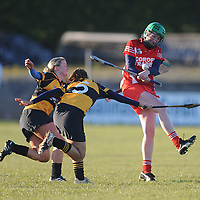 28 November 2010; Edel Keating, Corofin, Co. Clare, in action against Niamh Coyle and Aisling Fallon, Four Roads, Co. Roscommon. All-Ireland Junior Camogie Club Championship Final, Corofin, Co. Clare v Four Roads, Co. Roscommon, Duggan Park, Ballinasloe, Co. Galway. Picture credit: Ray Ryan / SPORTSFILE *** NO REPRODUCTION FEE ***
