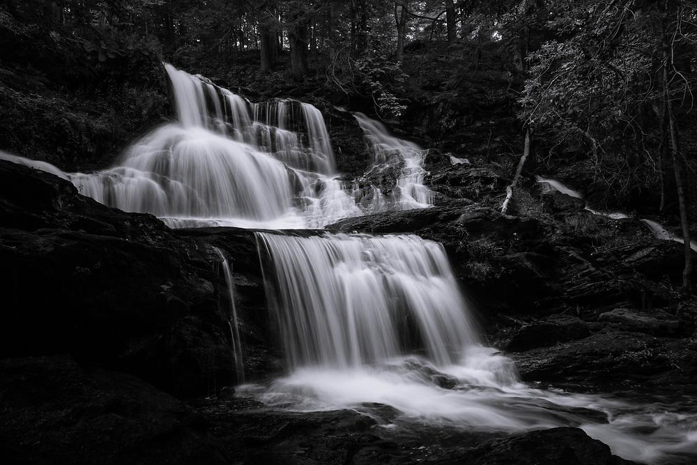 Mountain water flowing through the rocky cascades at Garwin Falls.