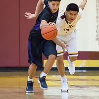 Darien Baca (24) of Miyamura steals the ball away from Rayshawn Whitney (3) of Tohatchi, near the half court line. The Patriots won 68-44 in Tohatchi on Thursday.