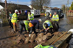 © Licensed to London News Pictures. Date 07/02/2014. Moorland, Somerset. Environment agency move sand bags.Evacuated village of Moorland in Somerset. All residents have been evacuated as the flood waters continue to rise today.. Photo credit : MarkHemsworth/LNP