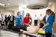 Tuesday 17th February, 2015, Aberdeen, Scotland. First Minister Nicola Sturgeon opens the new £13.6 million Radiotherapy Department at Aberdeen Royal Infirmary.<br /> <br /> Pictured: L-R Cindy McIntosh, Radiographer, First Minister Nicola Sturgeon and Jenny MacBeat, Senior Therapy Radiographer Peter Houston who demonstrates the linear accelerator machine<br /> <br /> <br /> <br /> <br /> (Photo: Newsline Media)