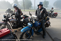 Pat Simmons of the Doobie Brothers on his 1929 Harley-Davidson JD with his wife Cris Sommer Simmons on her 1934 Harley-Davidson VD at a gas stop after riding through the fog during stage 8 of the Motorcycle Cannonball Cross-Country Endurance Run, which on this day ran from Junction City, KS to Burlington, CO., USA. Saturday, September 13, 2014.  Photography ©2014 Michael Lichter.