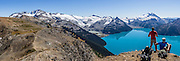 From stunning Panorama Ridge, admire the vibrant turquoise color of Garibaldi Lake, which comes from glacial flour suspended in meltwater from Sphinx and Sentinel Glaciers. Garibaldi Provincial Park is east of the Sea to Sky Highway (Route 99) between Squamish and Whistler in the Coast Range, British Columbia, Canada. A hiking loop to Garibaldi Lake via Taylor Meadows Campground is 11 miles (18k) round trip, with 3010 ft (850m) gain. Panorama Ridge is 6 miles (10k) RT with 2066 ft (630m) gain from either Taylor Meadows or Garibaldi Lake Campground (or 17 miles RT with 5100 ft gain from Rubble Creek parking lot). This panorama was stitched from 3 overlapping images.