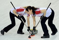 12-02-2014 CURLING: OLYMPIC GAMES: SOTSJI<br /> Japan verslaat Rusland met 8-4. Alexandra Saitova, Ekaterina Galkina<br /> ©2014-FotoHoogendoorn.nl
