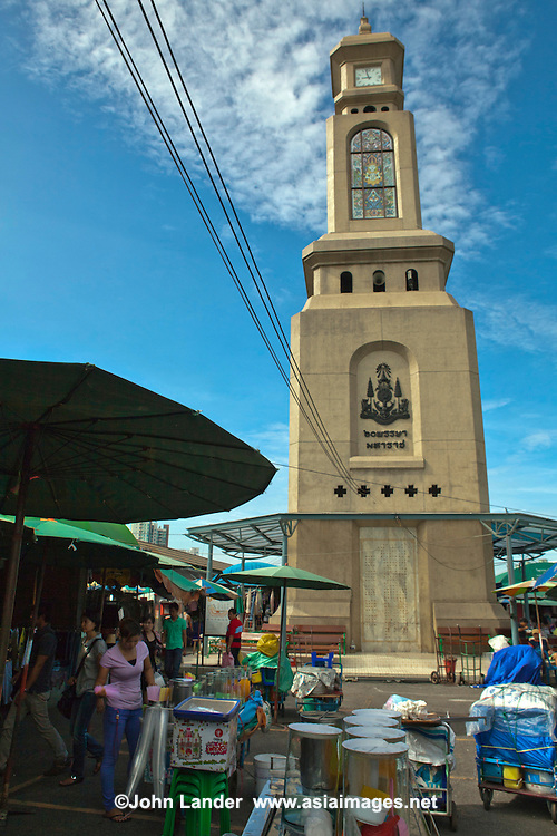 Chatuchak Clocktower - Chatuchak Market or sometimes called the  Weekend Market is the largest market in Thailand, and one of the largest in the world covering over 35 acres with more than 5,000 stalls not counting wandering vendors and street entertainers. It is estimated that the market receives between 200,000 and 300,000 visitors each day on Saturdays and Sundays. The market offers a wide variety of products including household items, hats, clothing, Thai crafts, religious artifacts, collectibles, foods, and even live animals.