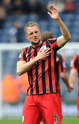 Queens Park Rangers' Clint Hill applauds the fans as he puts his hand on the crest of QPR - Photo mandatory by-line: Dougie Allward/JMP - Mobile: 07966 386802 - 04/04/2015 - SPORT - Football - West Bromwich - The Hawthorns - West Bromwich Albion v QPR - Barclays Premier League