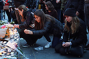 Lighting Candles. Place Republique, Parisians pay hommage to those killed and wounded in the Terrorist attacks<br /><br />The Day after the terrorist jihadi attacks. Bullet holes and blood, mourning homage and cleaning up. Aftermath of deadly Paris terrorist attacks. Saturday 14th November 2015<br /> <br /> Eight terrorists dead and some 128 people killed at Stade de France, Bataclan concert Hall, Belle Equipe Restaiurant, Rue Fontaine au Roi, Two hundred people have been injured, 80 of them seriously.
