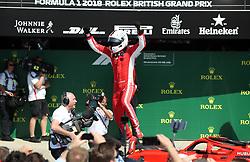Ferrari's Sebastian Vettel celebrates winning the 2018 British Grand Prix at Silverstone Circuit, Towcester.