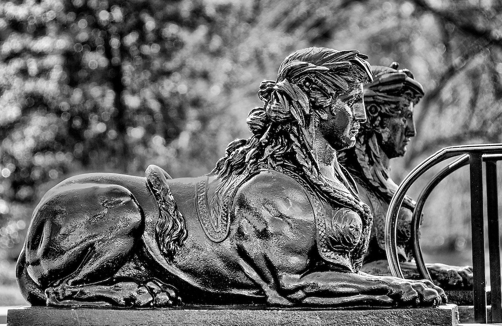 Two sphinxes on guard.  While there was plenty of color in the background, these two come across much better in black and white.  While very different from their more famous namesake in Egypt, they meet the definition of sphinxes.
