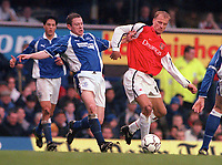 Dennis Bergkamp (Arsenal) holds off Gary Naysmith (Everton). Everton v Arsenal. FA Premiership 18/11/2000. Credit: Colorsport / Andrew Cowie.