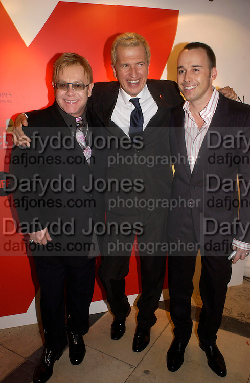 Sir Elton John, Mario Testino and David Furnish. Mario Testino, Bianca Jagger and Kenneth Cole celebrate Women to Women: Positively Speaking. - A publication to raise awareness of women living with Aids. The Orangery, Kensington Palace. 2 December 2004. ONE TIME USE ONLY - DO NOT ARCHIVE  © Copyright Photograph by Dafydd Jones 66 Stockwell Park Rd. London SW9 0DA Tel 020 7733 0108 www.dafjones.com