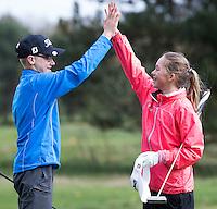 LOCHEM -  High five na afloop van de wedstrijd. Jeugdgolf op de  Lochemse Golf Club De Graafschap. COPYRIGHT KOEN SUYK