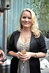 GEORGIA BLAKEY at the Total Concierge launch party held in the stylish Courtyard Garden at Sanderson, Berners Street, London on 26th May 2009.