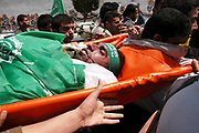 Palestinians carry the body of Eyad Al-Taharawi, a Hamas militant during his funeral in Gaza. Israeli troops shot dead three armed Palestinian militants who slipped into a Jewish settlement in Gaza before dawn on April 12, 2004, to carry out an attack, an IDF spokeswoman said.