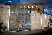 Large metal security gates of an internal secure fence that surrounds a wing and exercise yard of HMP Pentonville, London, UK. (Photo by Andy Aitchison)