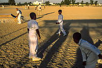 Dubai, United Arab Emirates | 2004<br /> Boys learn to play cricket at a camp in the desert outside the city of Dubai.
