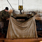 Santa Croce Sull'Arno, Italy. Italcuoio tannery SPA. Skins at the phase of slow tanning in the tank. This type of tanning lasts several days. The vegetable tannins penetrate the skin, making them very durable. This is how leather for shoe soles is created.