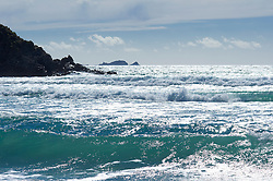 Waves surf breaking ocean shore turquoise cliff