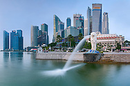Dawn view of the Singapore skyline and the Merlion fountain in Singapore.