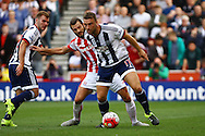 Rickie Lambert of West Bromwich Albion shields the ball from Erik Pieters of Stoke City. Barclays Premier League match, Stoke city v West Bromwich Albion at the Britannia stadium in Stoke on Trent, Staffs on Saturday 29th August 2015.<br /> pic by Chris Stading, Andrew Orchard sports photography.