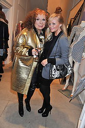 Left to right, JENNIFER SAUNDERS as her TV character Edina Monsoon and EMMA BUNTON at a party to celebrate the switching on of the Christmas Lights at the Stella McCartney store, Bruton Street, London on 29th November 2011.
