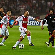 NLD/Amsterdam/20100928 - Champions Leaguewedstrijd Ajax - AC Milan, Demy de Zeeuw in duel met Andrea Pirlo
