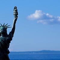 USA, Washington, Seattle, Miniature sculpture of Statue of Liberty along Alki Beach in West Seattle