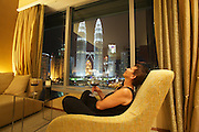 Malaysia, Kuala Lumpur. Petronas Twin Towers, the tallest buildings on Earth from 1998-2004 (still the tallest twin buildings), seen from a Deluxe Twin Tower Room.