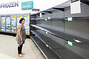 Woolworths Supermarket in Double Bay, Sydney showing empty shelves to a customer.
