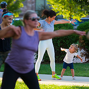Ava Sommerville, 2, exercises alongside her mother Jen during a Jazzersize group on the lawn of the New Bohemia Market in Cedar Rapids, Iowa. Nathan Lambrecht/Journal Communications