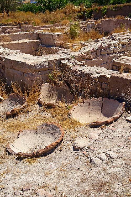 Remains of storage pits & pots at the  Apollo Smintheion Sanctuary near Gulpinar Village Turkey. .<br /> <br /> Visit our TURKEY PHOTO COLLECTIONS for more photos to download or buy as wall art prints https://funkystock.photoshelter.com/gallery-collection/3f-Pictures-of-Turkey-Turkey-Photos-Images-Fotos/C0000U.hJWkZxAbg