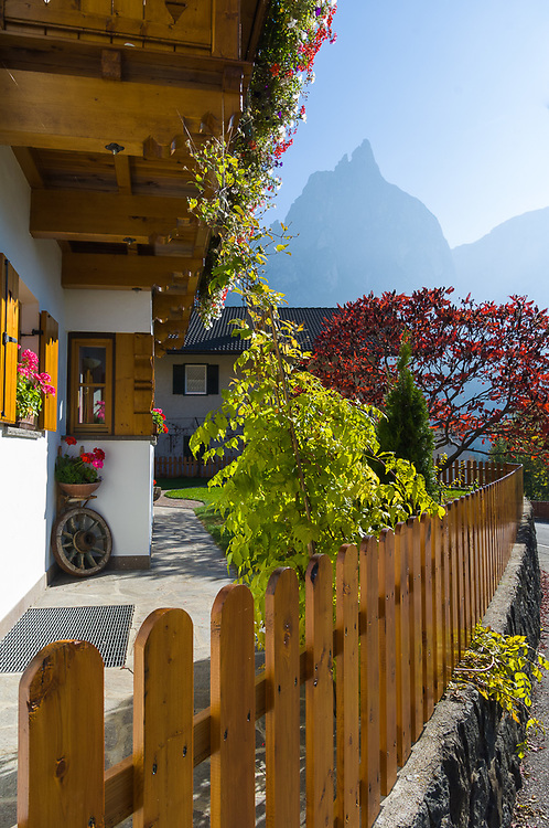 Tyrolian village with the Schlern as a backdrop (2, 563 meters elevation), October, Dolomite Mountains, N.E. Italy