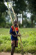 A boy holds 2 stems of sugar cane in Rutshuru, 70km north of Goma, Eastern Democratic Republic of Congo, on Thursday December 11, 2008..