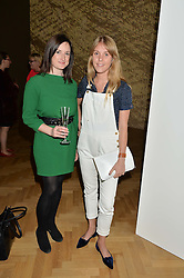Left to right, NICOLA CASEY and TOR DASHWOOD at a private view and auction of millinery organised by author, philanthropist and hat collector Eva Lanska in aid of Women for Women International held at Pace, Burlington Gardens, London on 10th June 2015.