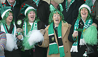 Photo. Andrew Unwin<br /> Yeovil v Liverpool, FA Cup Third Round, Huish Park, Yeovil 04/01/2004.<br /> Yeovil fans sing along to their FA Cup song.