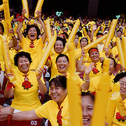Chinese spectators in the Olympic Stadium, Beijing, during the summer Olympic Games.  August 8 to August 24, 2008. Photo Tim Clayton