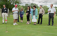 Bob Bolduc gives this group a tour of the golf course at Bolduc Park on Wednesday evening during the Business After Hours gathering.  (Karen Bobotas/for the Laconia Daily Sun)