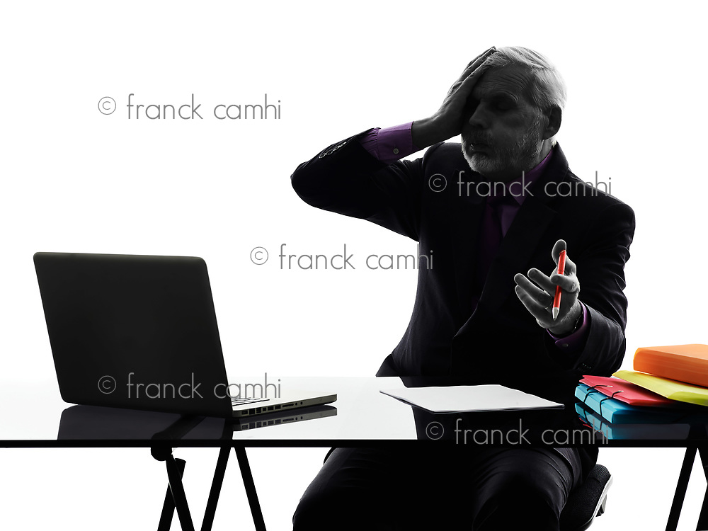 One Caucasian Senior Business Man computing laptop displeased Silhouette White Background